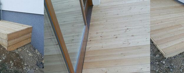 Lesena terasa iz sibirskega macesna položena v pralni pesek